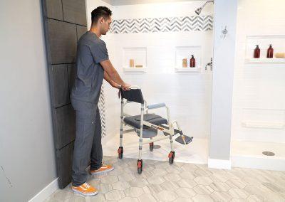 Eco Traveller SB7e with caretaker pushing into shower