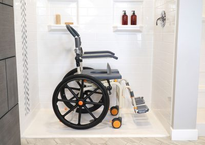 Roll-InBuddy Solo SB6w chair in roll-in shower