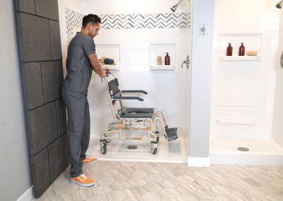 Roll-InBuddy Tilt SB3T with caregiver in shower