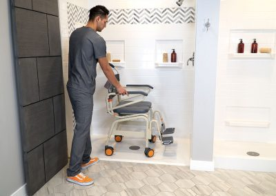 Roll-InBuddy XL SB6c-22 with caregiver in shower