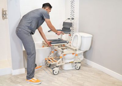 TubBuddy SB2 chair transitioning to bathtub with caregiver