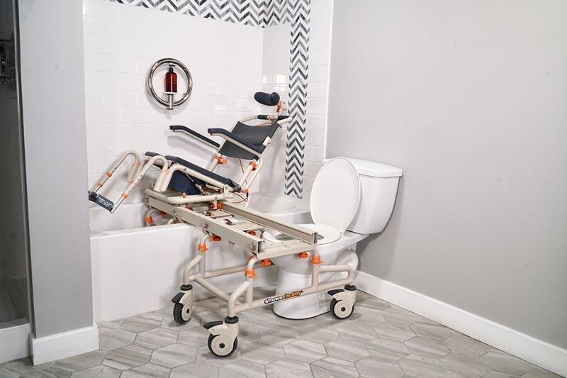 TubBuddy Tilt SB2T shown tilted in bathtub for bathroom mobility